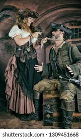 Lady Pirate Threatens Male Pirate with Flintlock Pistol
