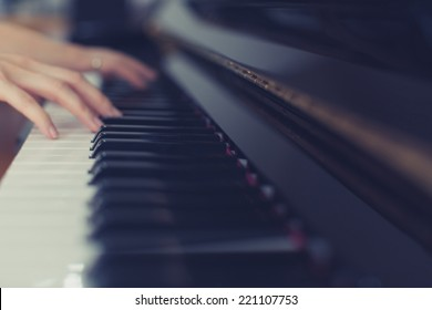 Lady playing piano with vintage look