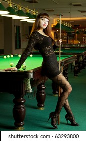 Lady in pool room