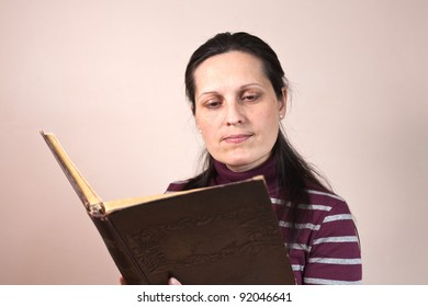 Lady reading a book carefully