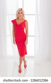 Lady in red classical fashionable midi dress, woman elegant fashion
