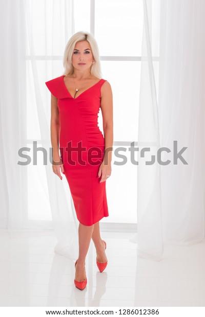 Lady Red Classical Fashionable Midi Dress Stock Photo (Edit