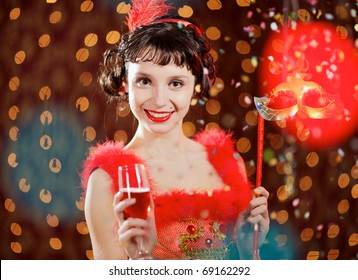 Lady in red dress at the carnival with champagne flute and mask at the flames background
