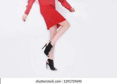 Lady in red sundress and black high hell shoes posing