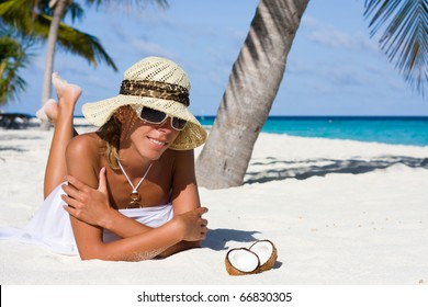 A lady is relax on a tropical beach