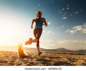 Lady running in the desert