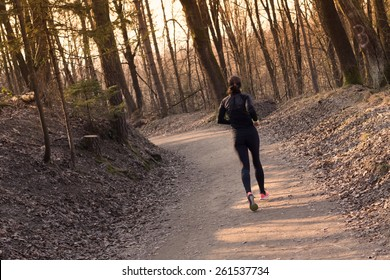 Lady running in the forest.  Running woman. Female runner jogging during outdoor workout in a Nature. Fitness model outdoors. Weight Loss. Healthy lifestyle.