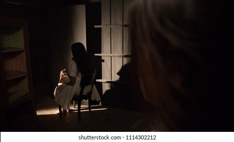 lady saw Thai lady ghost sitting on the chair with Thai ghost doll (Look Thep)