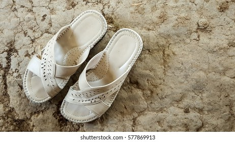 lady shoe slipper on soil ground