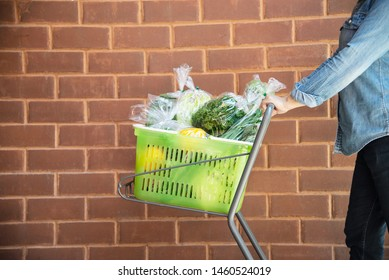 Lady is shopping fresh vegetable in supermarket store - woman in fresh market lifestyle concept