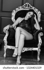 Lady sitting in a big chair black and white