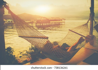 Lady sleep enjoying hammock tropical beach Home stay Resting place Fishing village sunset Beautiful summer vacations outdoor harmony nature Travel Lifestyle relaxation emotional concept of Bangsaray