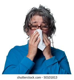 Lady sneezes, feeling unwell due to the flu
