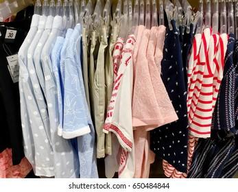 Lady style t-shirts on its rack waiting fir new customers. Bangkok, Thailand May 25,2017,