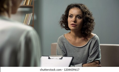 Lady suffering anxiety, discussing her issues with female expert in psychiatry