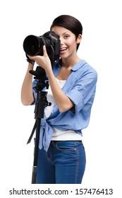 Lady takes snapshots holding photographic camera, isolated on white
