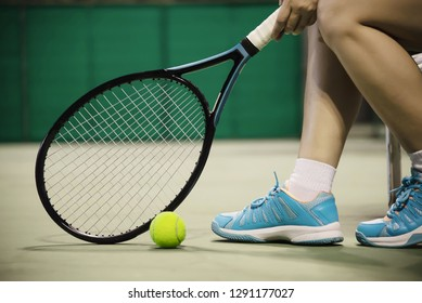 Lady tennis player sitting in the court during game break - people in sport tennis game concept