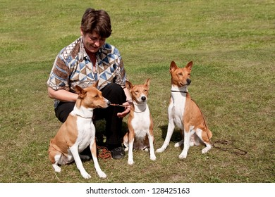 Lady with three Basenjis, mother son & daughter