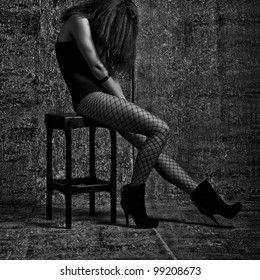 Lady in tights in a cage