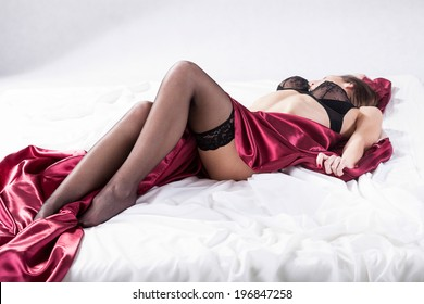 Lady waiting for sexual intercourse in bed