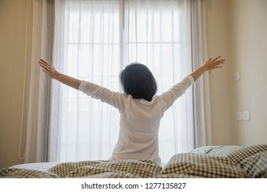 Lady wake up stretch oneself lazily for fresh morning - health care concept