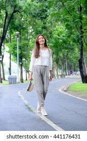Lady walking in the park