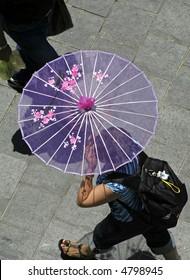 lady walking with pink parasol umbrella