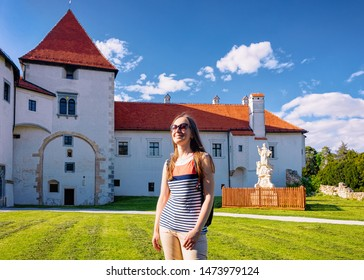 Lady wearing sunglasses at Castle at Street at Old city in Varazdin in Croatia. Panorama and Cityscape of famous Croatian fortress town in Europe in summer. Travel and tourism for tourists.