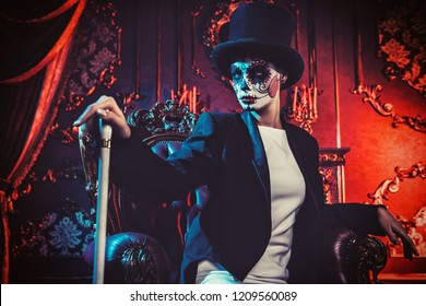 A lady wearing a tux in interior. Sugar skull makeup. Halloween.