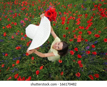 Lady with white hat and poppies bunch