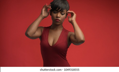 lady woman in red on red mixed race african american woman in red dress on red background