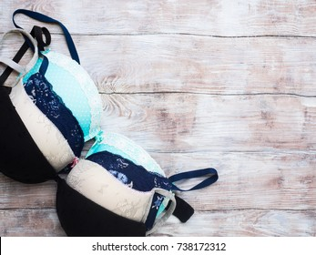 Lady's bra on wooden textured background. Lingerie shopping or underwear storage concept
