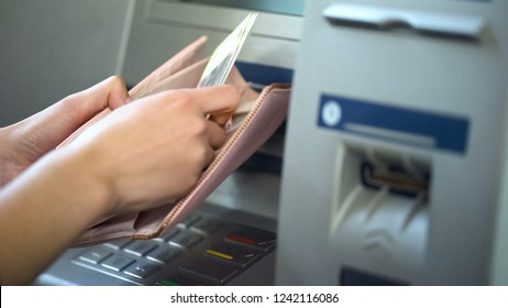 Ladys hands putting Russian rubles in wallet, cash withdrawn from ATM, tourism