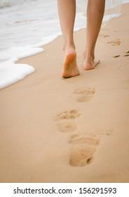 lady's leg walking on the beach