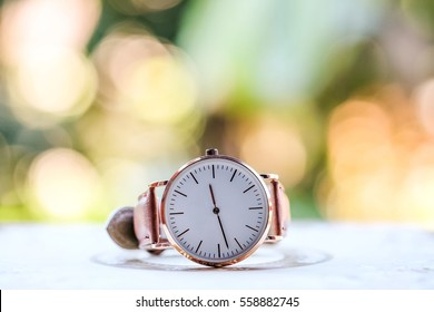 lady's rose golden watch isolated and bokeh background