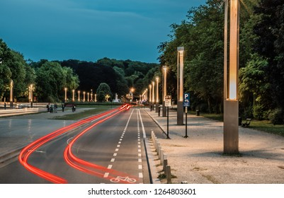 Laeken, Brussels / Belgium - Red light trails of a car driving through the large Avenue du Centenaire by night in summer