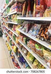 LAEM CHABANG, CHONBURI, THAILAND - SEPTEMBER 3, 2017: Milk, food, snacks and other items in convenience stores in Seven eleven.