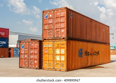 LAEM CHABANG, THAILAND - APRIL 22 , 2015 : Containers at Large commercial port at at Laem Chabang Industrial Estate early in the morning in Laem Chabang, Thailand on April 22, 2015