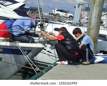 Laeso island, Denmark - July 18, 2011: The yacht crew fully occupied with the repairing of broken equipment