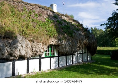 Laesoe / Denmark - August 2016: Hedwigs Hus cottage with it's old seaweed roof is a cultural heritage and part of the museum of the Danish Kattegat island