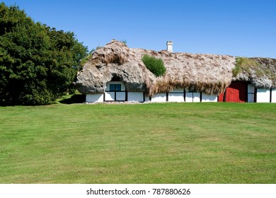 Laesoe / Denmark: Old half-timbered farmhouse thatched with a seaweed roof