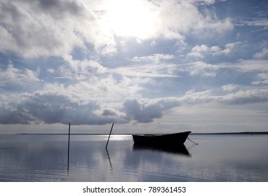 Laesoe / Denmark: Small fishing boat anchoring in the bay at Bloeden Hale