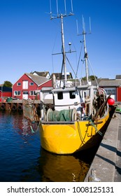 Laesoe / Denmark: Yellow fishing boat in the small fishing port of Vesteroe Havn