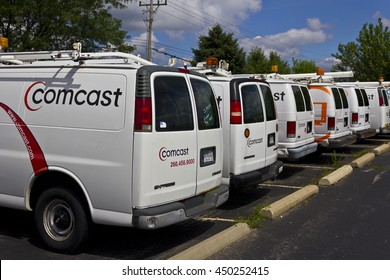 Lafayette, IN - Circa July 2016: Comcast Service Vehicles. Comcast is a Multinational Mass Media Company IV