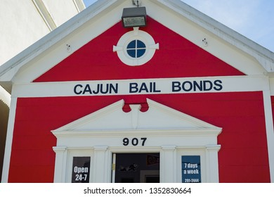 LAFAYETTE, L.A. / USA - MARCH 27, 2019: Cajun Bail Bonds little red woodend building is locted down town Lafayette, Louisiana.