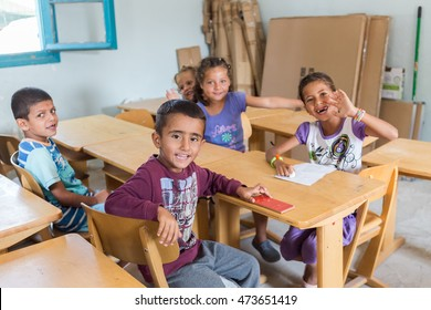Lagadikia, Greece - August 25, 2016: Children sit in a classroom in the refugee camp of Lagadikia, some 40km North of Thessaloniki, during the visit of UN high commissioner for refugees Filippo Grandi