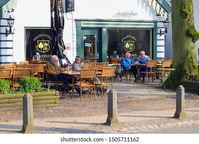 LAGE VUURSCHE, BAARN, NETHERLANDS - March 11, 2018. Senior people are drinking coffee and refreshments at outdoor street cafe terrace and family restaurant in springtime. Residence of princess Beatrix