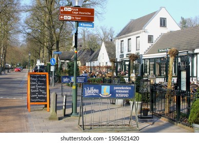 LAGE VUURSCHE, BAARN, NETHERLANDS - March 11, 2018. People are eating and drinking at outside terrace of cafe restaurant, serving poffertjes (Dutch pancakes) and beer. Residence of pincess Beatrix.
