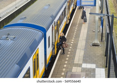 LAGE ZWALUWE, THE NETHERLANDS – JANUARY 29: Passenger train rides inside station to let passengers in and out on January 29, 2017