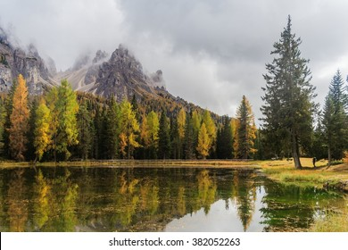 Lago Antorno with mauntain reflected in the lake and trees in autumn colours